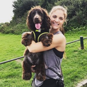 Laura with dog in arms